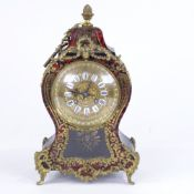 A 19th century French tortoiseshell and brass boulle work 8-day mantel clock, shaped case with glass