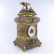 A large 19th century French brass architectural 8-day mantel clock, cream enamel dial with Arabic