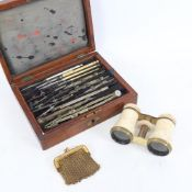An early 20th century drafting set, bone-mounted opera glasses, and a gilt-metal evening purse (3)