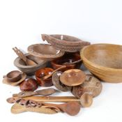 A quantity of treen items, including a turned wood fruit bowl, 34cm, spoons, letter opener,