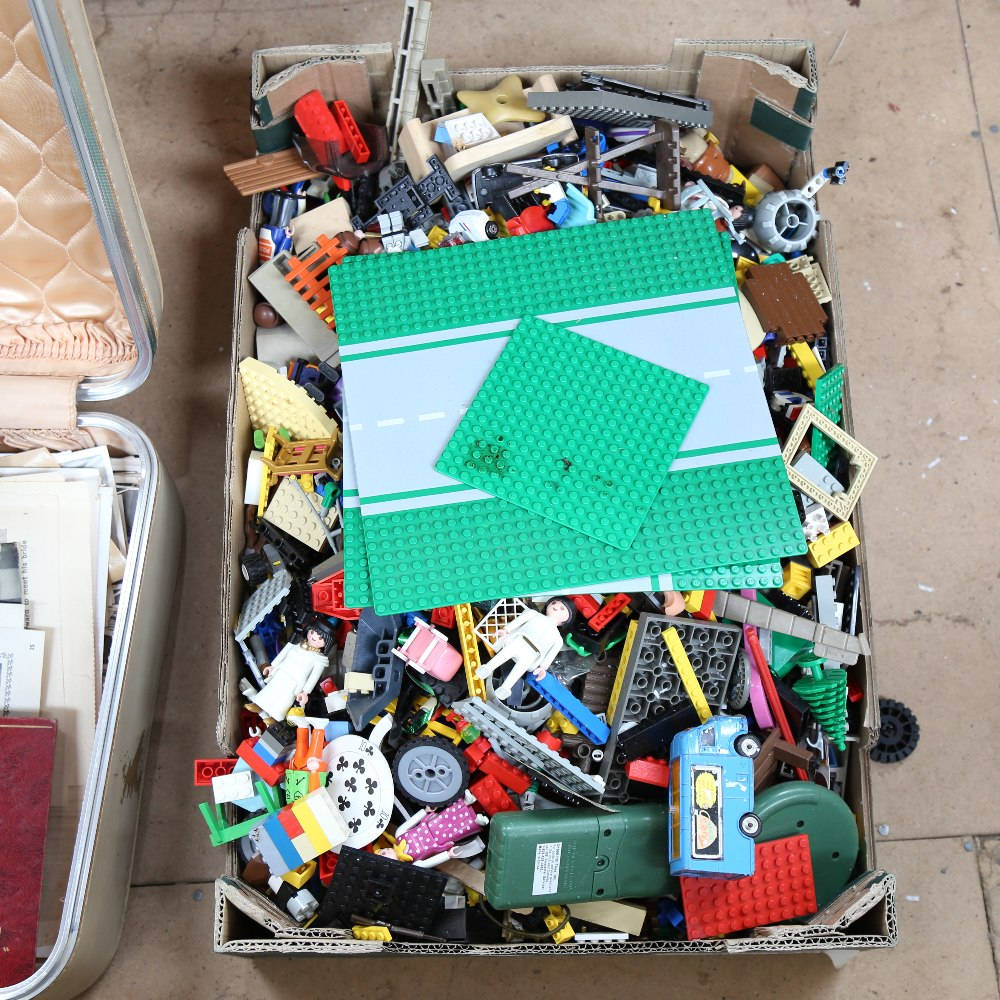 A box of Vintage LEGO and figures