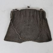 A French Art Deco silver evening bag/purse, chainmail body with cast frame and cable link handle,