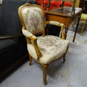 A Continental carved and stained beech-framed open-arm bedroom chair, with tapestry panels