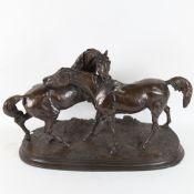 After Pierre-Jules Mene, a bronzed resin equestrian group sculpture, L'Accolade, signed, base length