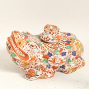 A large Oriental Imari style ceramic toad/frog, with baby toad stopper and allover floral