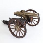A detailed desktop model of a Gatling field gun, with brass plaque stamped Hartford, Conn, working