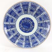 A very large Chinese blue and white charger, allover floral decoration with 6 character mark on