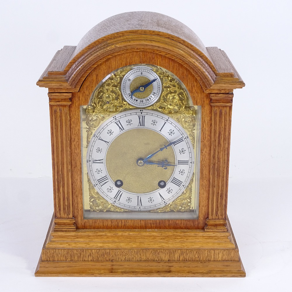 A late 19th/early 20th century German light oak-cased dome-top mantel clock, by Lenzkirch,