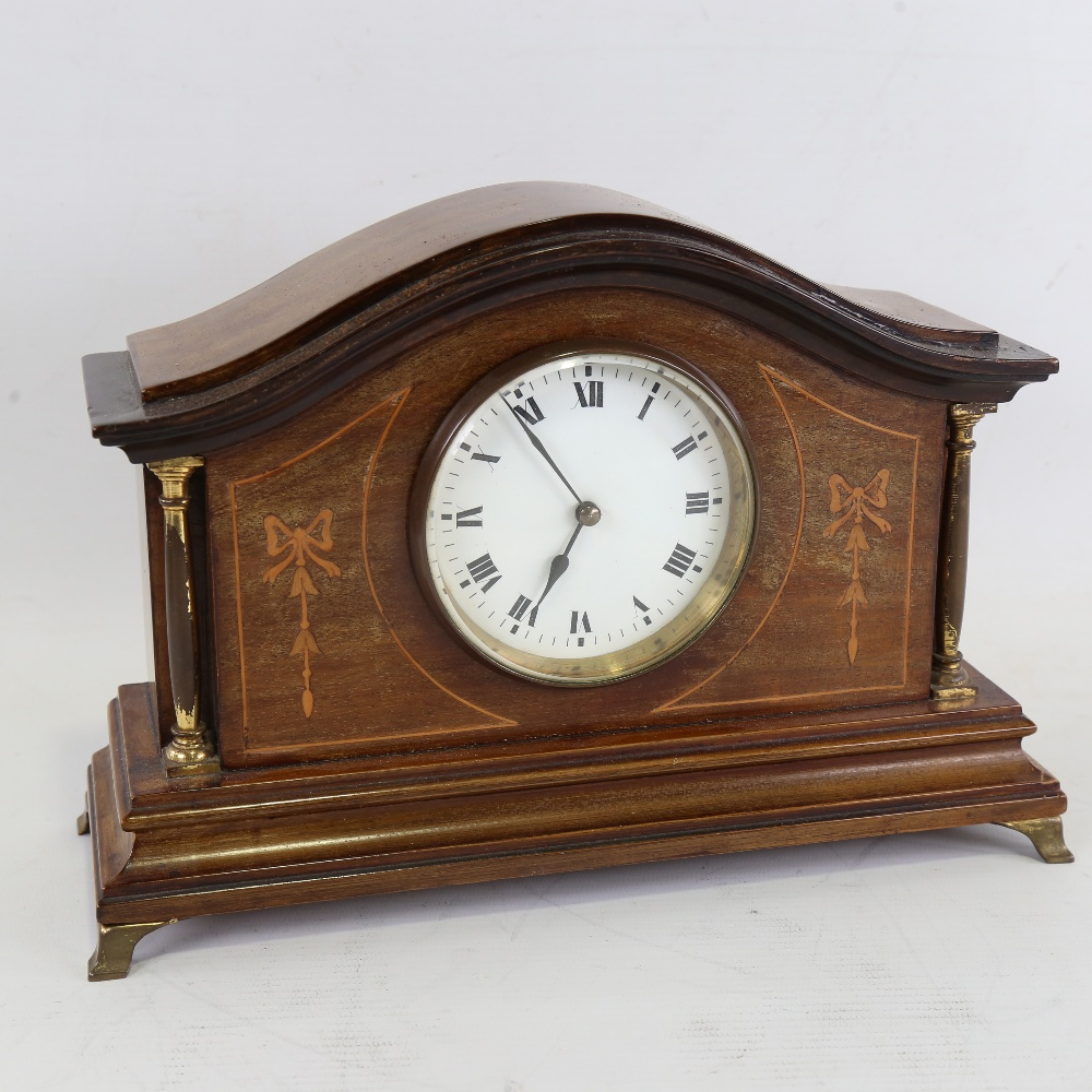 A French inlaid mahogany dome-top mantel clock, white enamel dial with Roman numeral hour markers,
