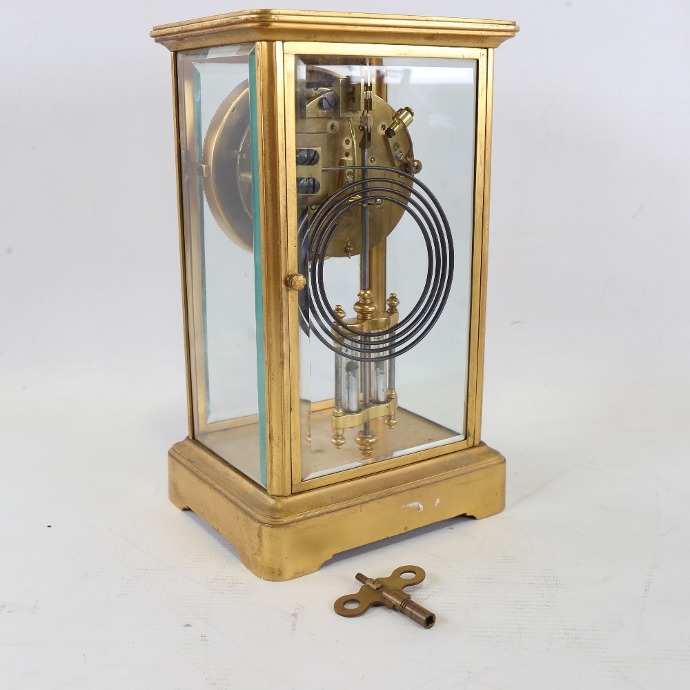 An early 20th century French brass-cased 4-glass 8-day mantel clock, floral white enamel dial with - Image 3 of 5