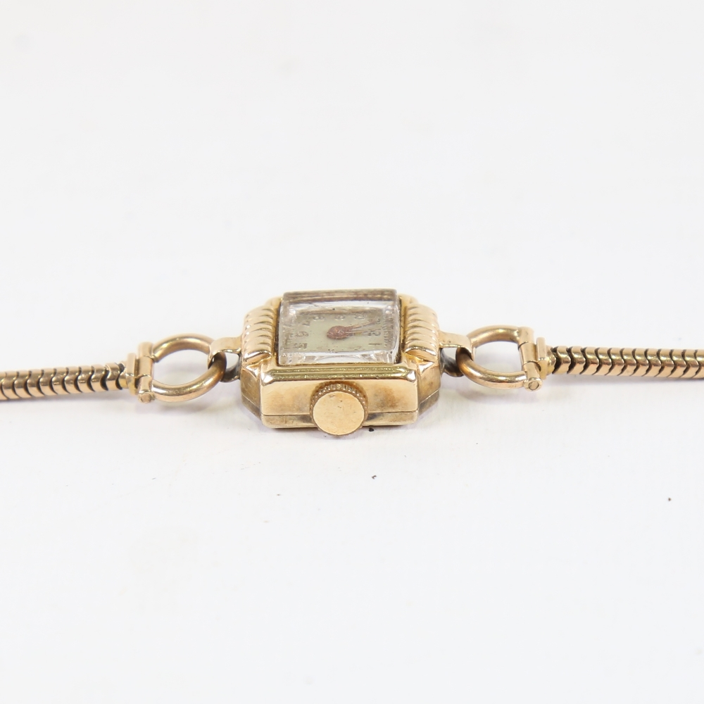 A lady's Vintage 14ct gold mechanical wristwatch, on 9ct snake link strap, not currently working, - Image 4 of 5