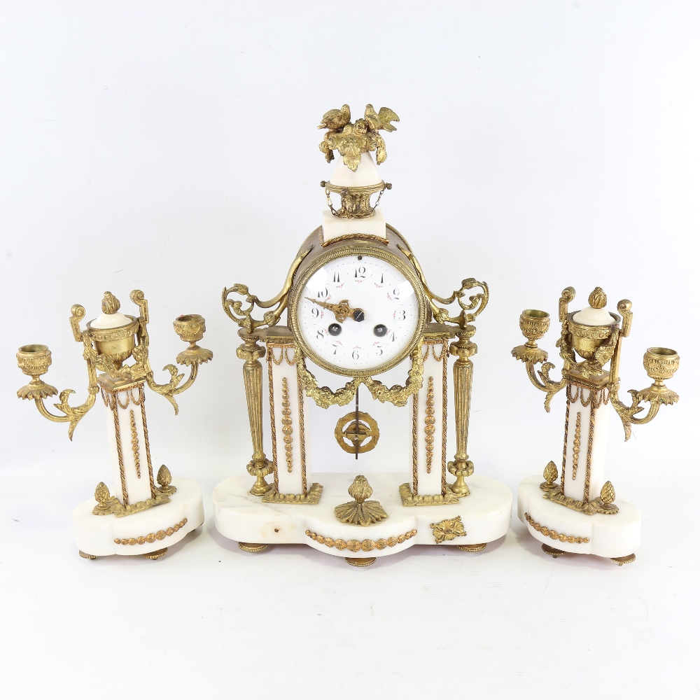 A 19th century French white marble and brass-cased 3-piece 8-day drum mantel clock garniture, floral