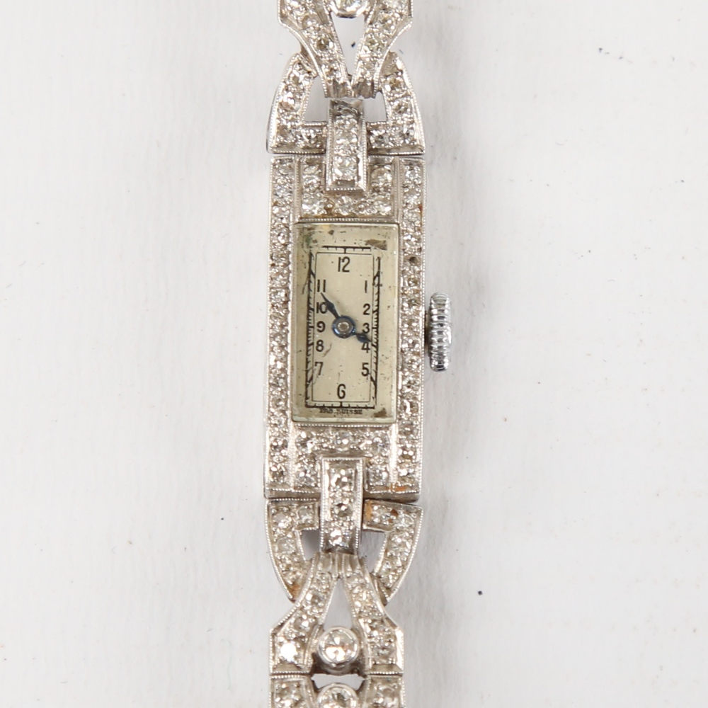 A lady's Art Deco platinum and diamond mechanical cocktail wristwatch, rectangular case with