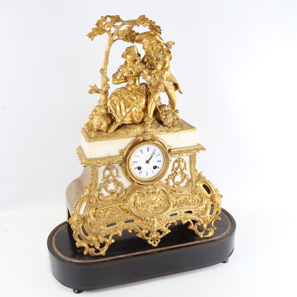 A large 19th century French gilt-bronze 8-day mantel clock, indistinct maker, white enamel dial with