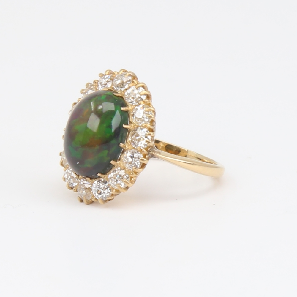 An early 20th century 18ct gold black opal and diamond cluster ring, set with oval high cabochon - Image 2 of 5