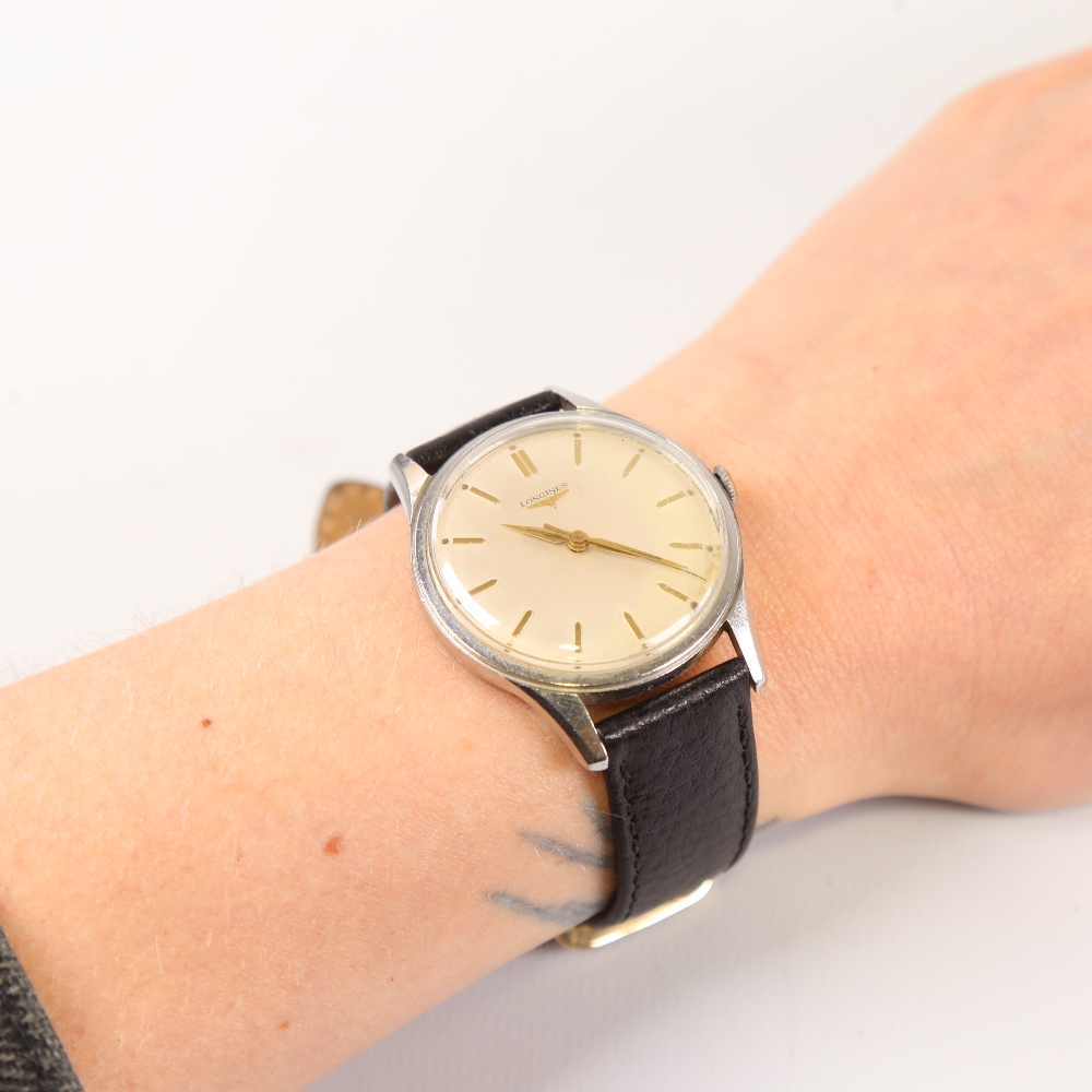 LONGINES - a Vintage stainless steel mechanical wristwatch, ref. 6995-1, silvered dial with gilt - Image 5 of 5