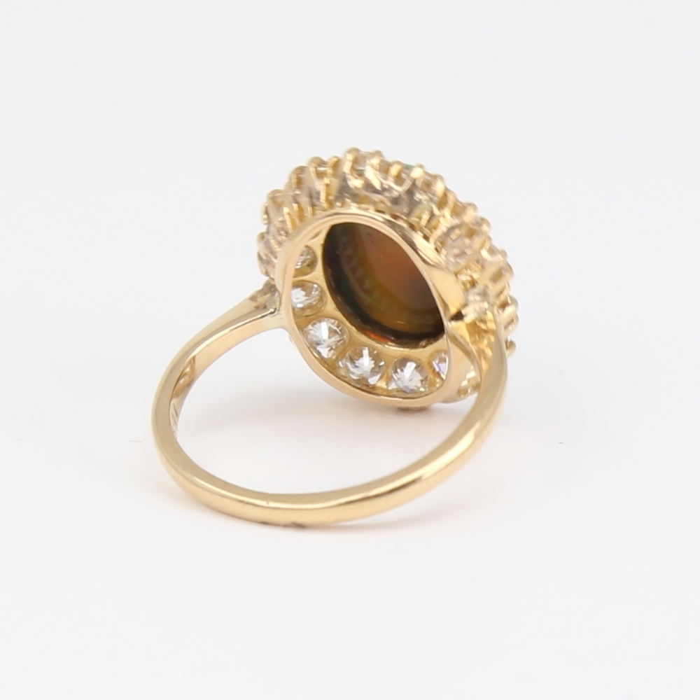 An early 20th century 18ct gold black opal and diamond cluster ring, set with oval high cabochon - Image 3 of 5