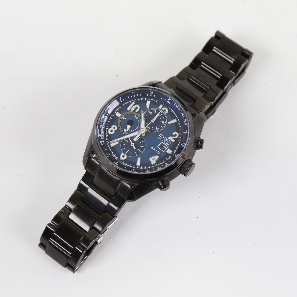 CITIZEN - a black ion-plated stainless steel Eco-drive WR100 quartz chronograph wristwatch, ref. - Image 2 of 5