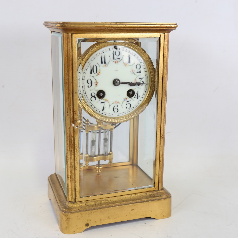 An early 20th century French brass-cased 4-glass 8-day mantel clock, floral white enamel dial with