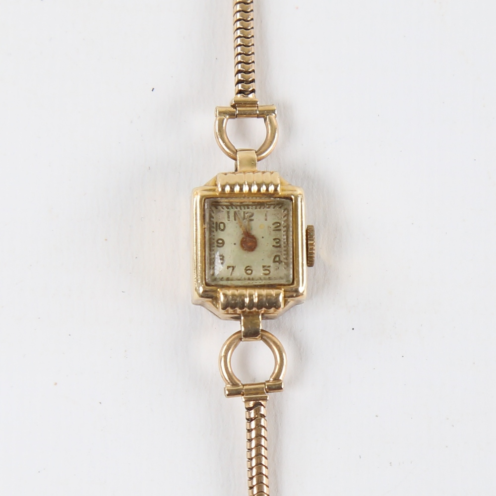 A lady's Vintage 14ct gold mechanical wristwatch, on 9ct snake link strap, not currently working,