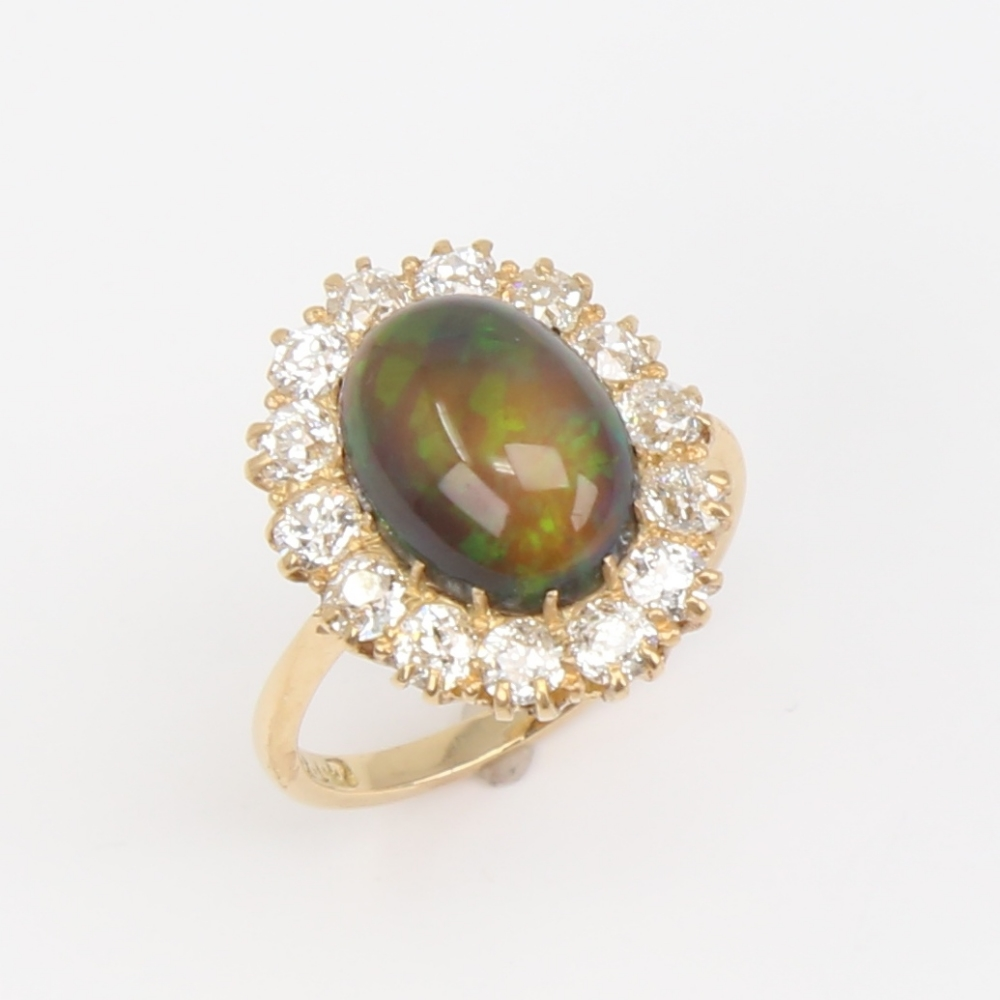 An early 20th century 18ct gold black opal and diamond cluster ring, set with oval high cabochon - Image 4 of 5