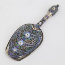 A Russian silver and champleve enamel sugar shovel, mark of Antip Kuzmichev of Moscow, made for