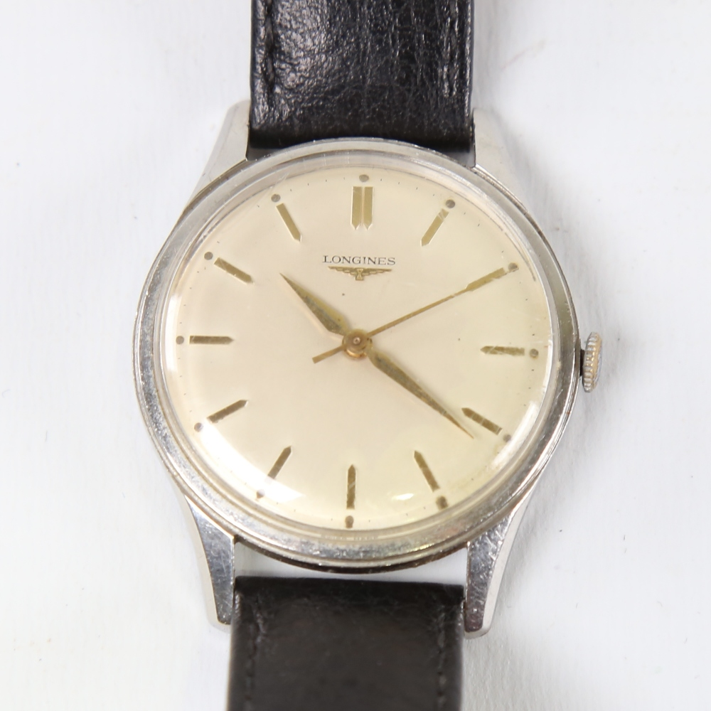 LONGINES - a Vintage stainless steel mechanical wristwatch, ref. 6995-1, silvered dial with gilt