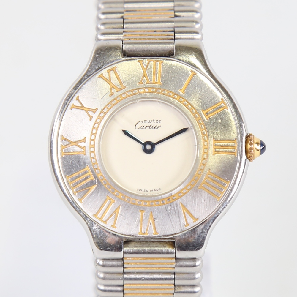 CARTIER - a lady's stainless steel Must De Cartier 21 quartz wristwatch, silvered dial with blued