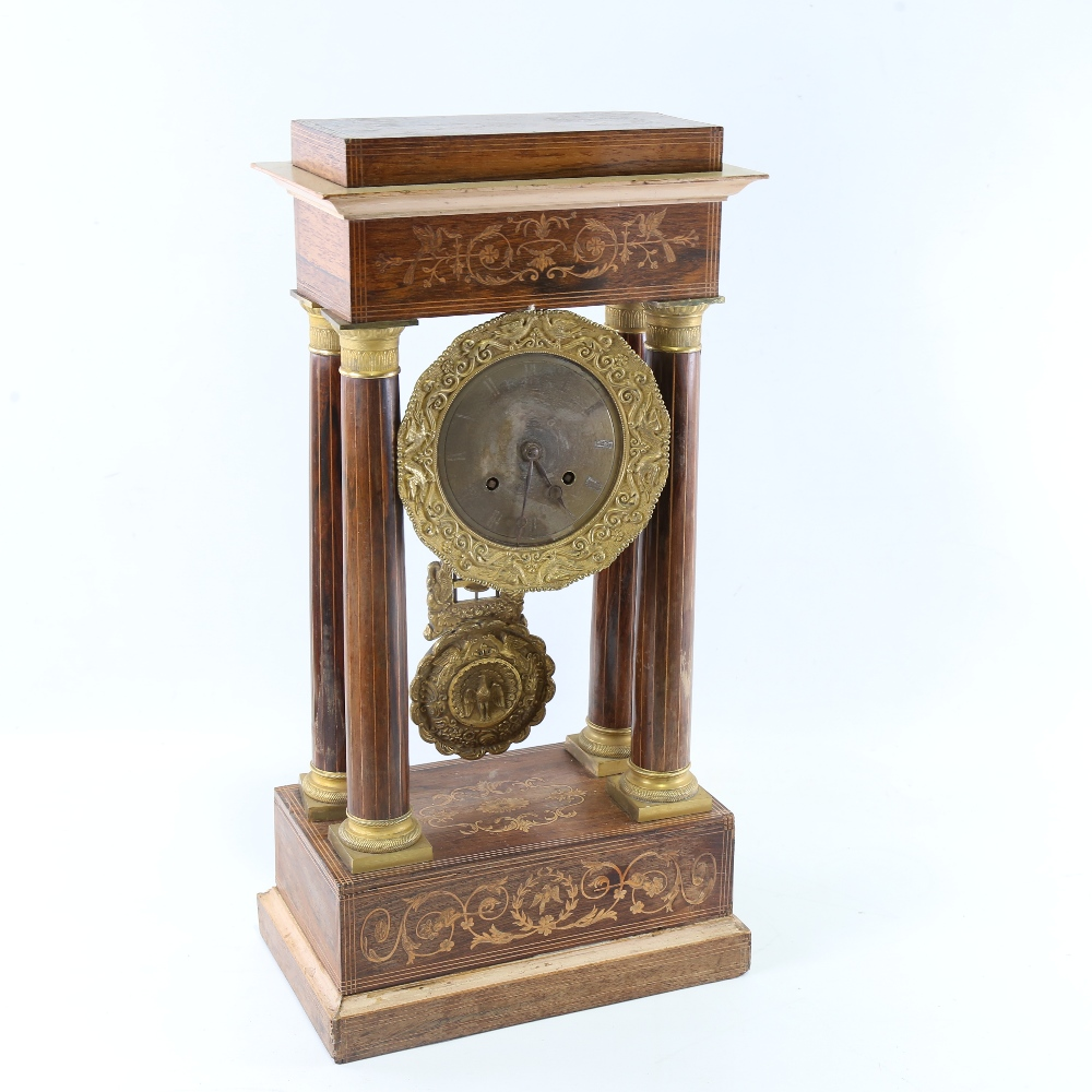 A 19th century rosewood and satinwood inlaid brass 4-pillar portico mantel clock, silvered dial with