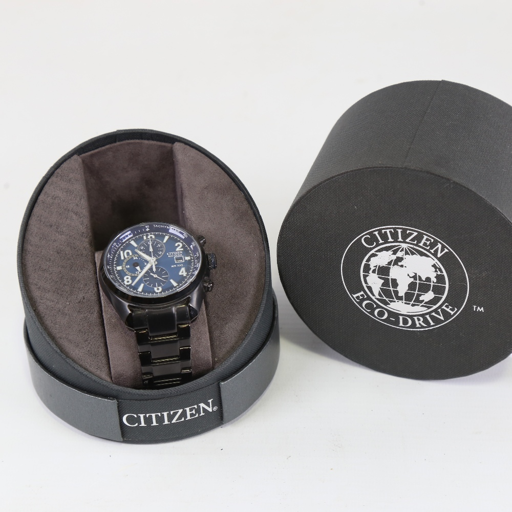 CITIZEN - a black ion-plated stainless steel Eco-drive WR100 quartz chronograph wristwatch, ref. - Image 5 of 5