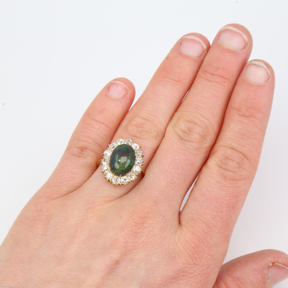An early 20th century 18ct gold black opal and diamond cluster ring, set with oval high cabochon - Image 5 of 5