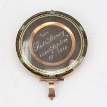 A fine and large Georgian mourning pendant, circular form with unmarked yellow metal frame, the