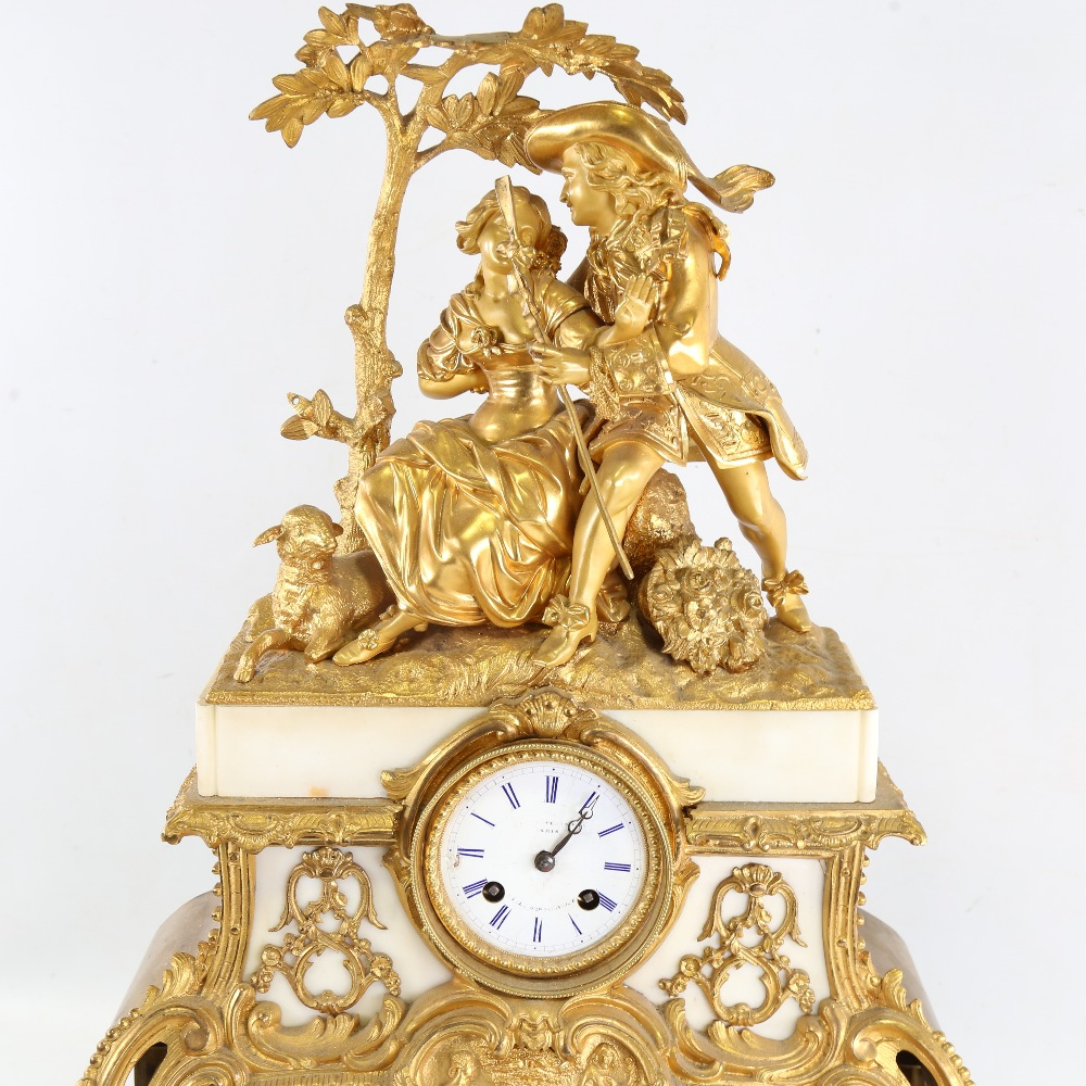 A large 19th century French gilt-bronze 8-day mantel clock, indistinct maker, white enamel dial with - Image 2 of 5