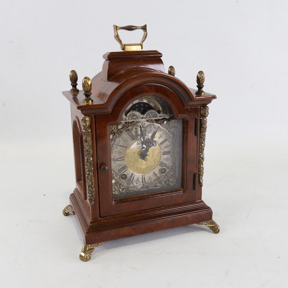 A Georgian style reproduction walnut-cased 8-day dome-top bracket clock, by Warmink Wuba, brass