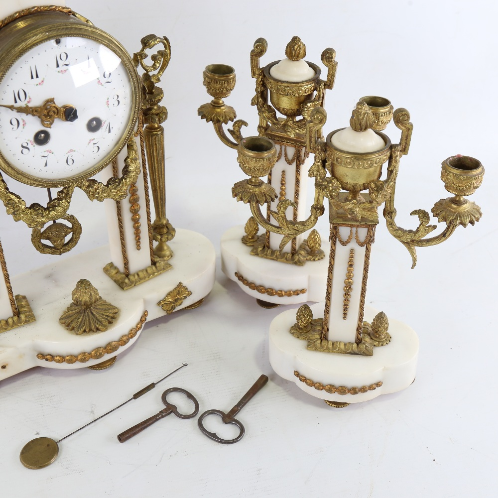 A 19th century French white marble and brass-cased 3-piece 8-day drum mantel clock garniture, floral - Image 5 of 5