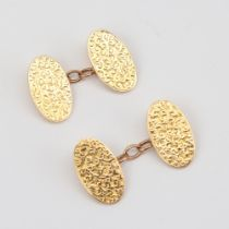 A pair of late 19th century 15ct gold cufflinks, oval panels with engraved foliate decoration, by BH