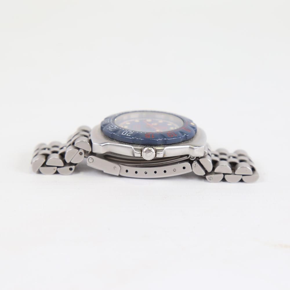 TAG HEUER - a stainless steel Formula 1 Professional 200M quartz wristwatch, ref. WA1210, blue - Image 4 of 5