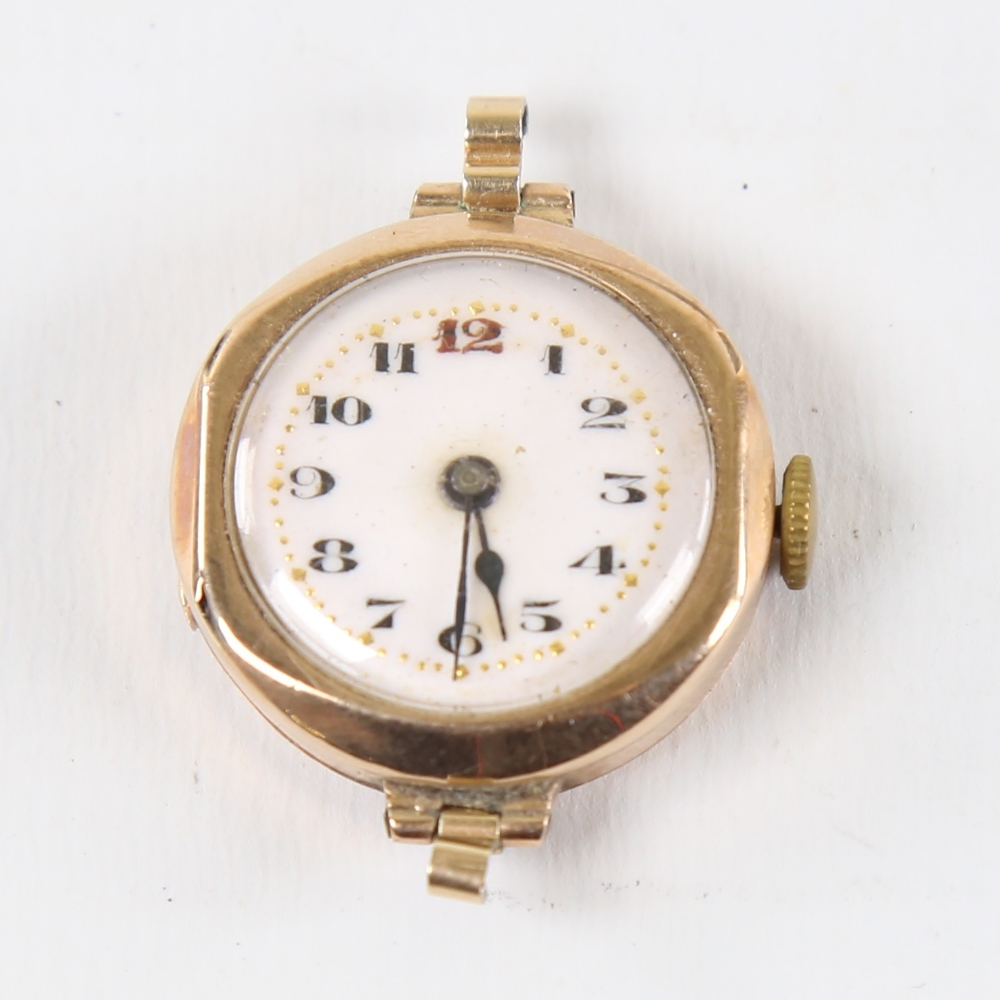 A Vintage 9ct gold mechanical wristwatch head, by Metrose Watch Co, white enamel dial with hand