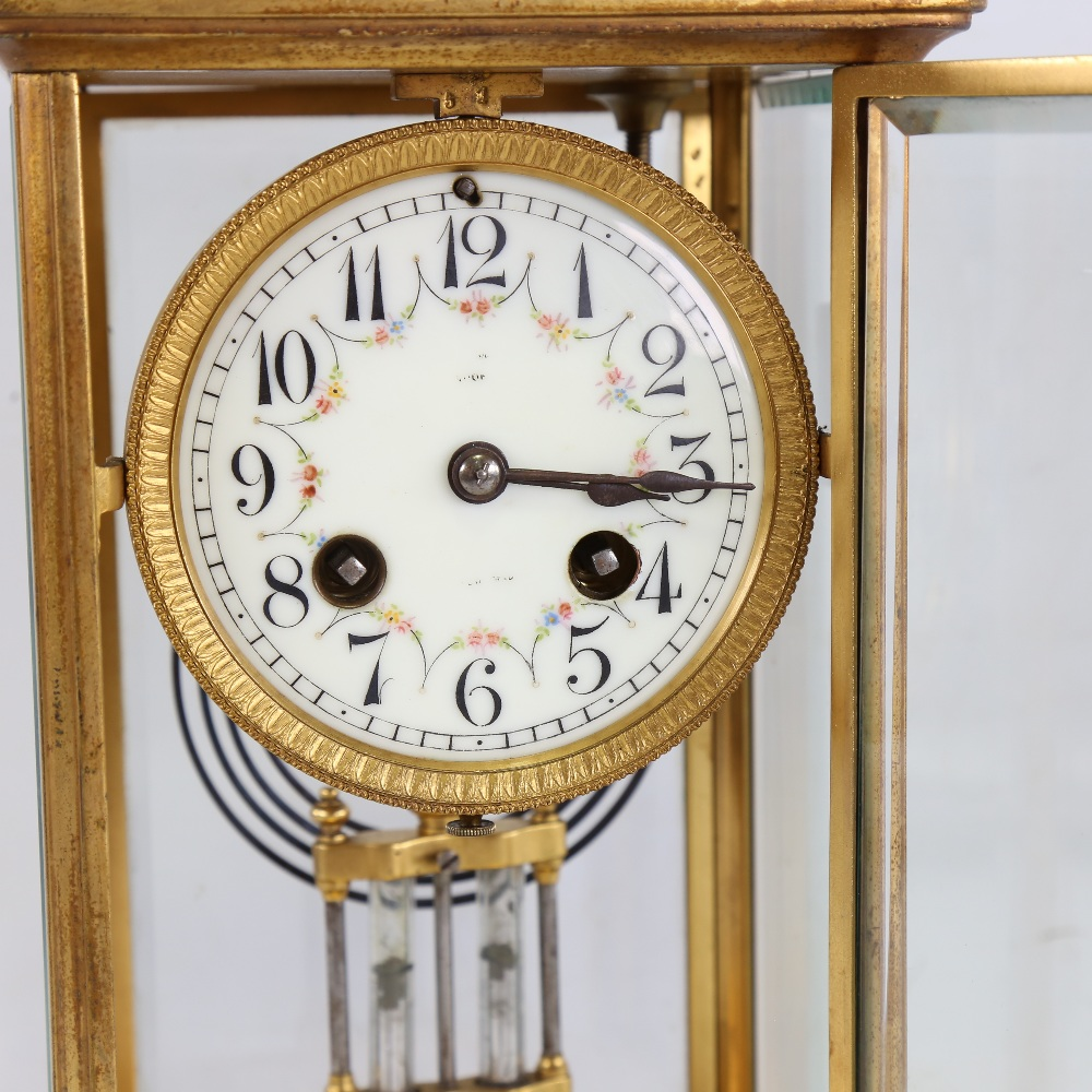 An early 20th century French brass-cased 4-glass 8-day mantel clock, floral white enamel dial with - Image 2 of 5