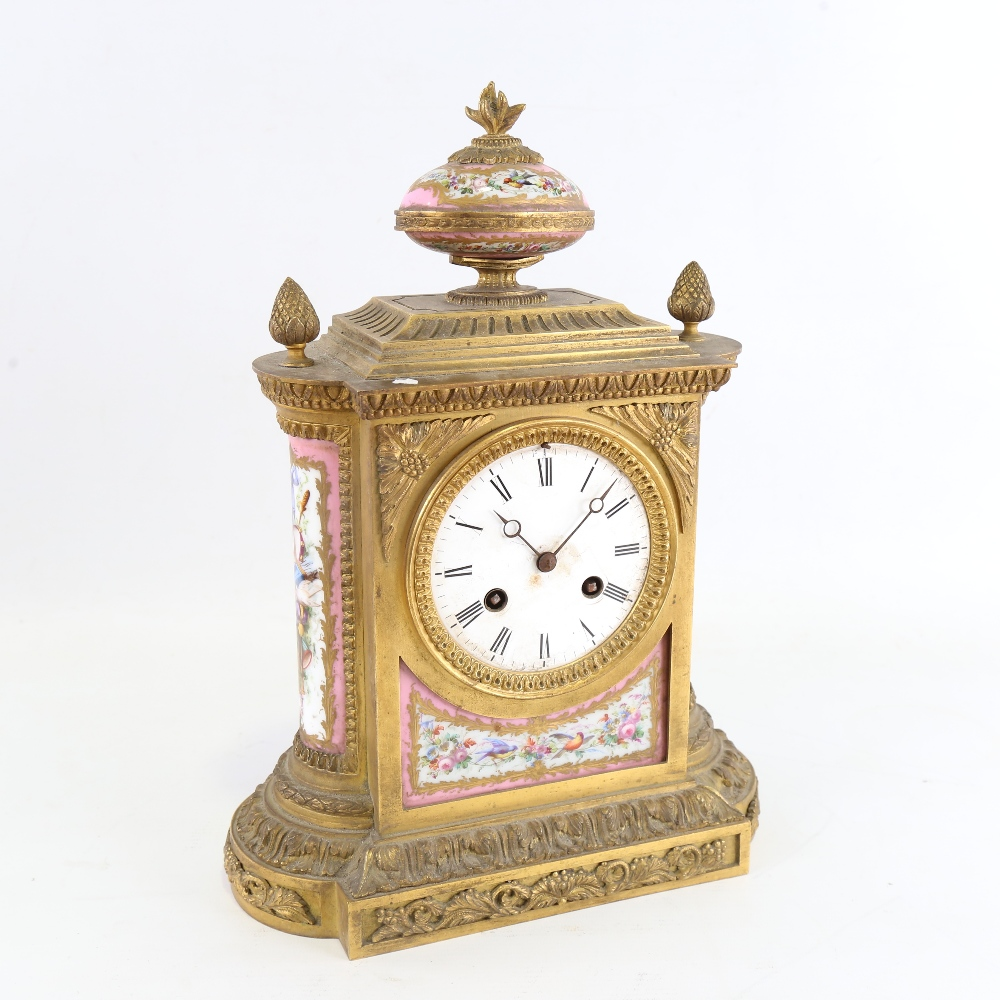 A French gilt-brass and Sevres Rose Pompador porcelain panel 8-day mantel clock, by Charles