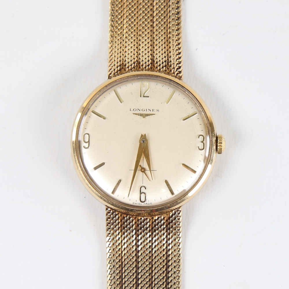 LONGINES - a Vintage 9ct gold mechanical wristwatch, circa 1966, silvered dial with quarterly gilt