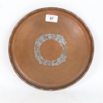An Arts and Crafts hammered copper tray, by Hugh Wallis, diameter 28cm