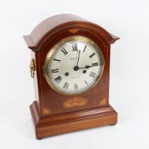 An early 20th century satinwood inlaid stained oak dome-top 8-day mantel clock, dial by Wootton of