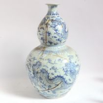 A large Chinese blue and white 'dragon' double-gourd vase, height 65cm