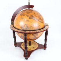 A reproduction table-top globe drinks cabinet, height 55cm, diameter 41cm