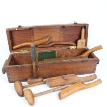 Various Vintage hand carved mallets, paddles, a Sorby spirit level, in hardwood box