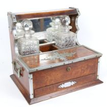 A Vintage chrome-mounted oak tantalus, with mirror-back, folding compartments and drawer, needs