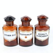 A set of 3 brown glass apothecary shop jars and stoppers, height 17cm