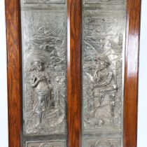 A large Victorian 2-section cast-iron fire screen, relief figural decoration with oak frame,