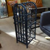 A scrolled wrought-iron arch-top wine cabinet for 22 bottles, height 87cm